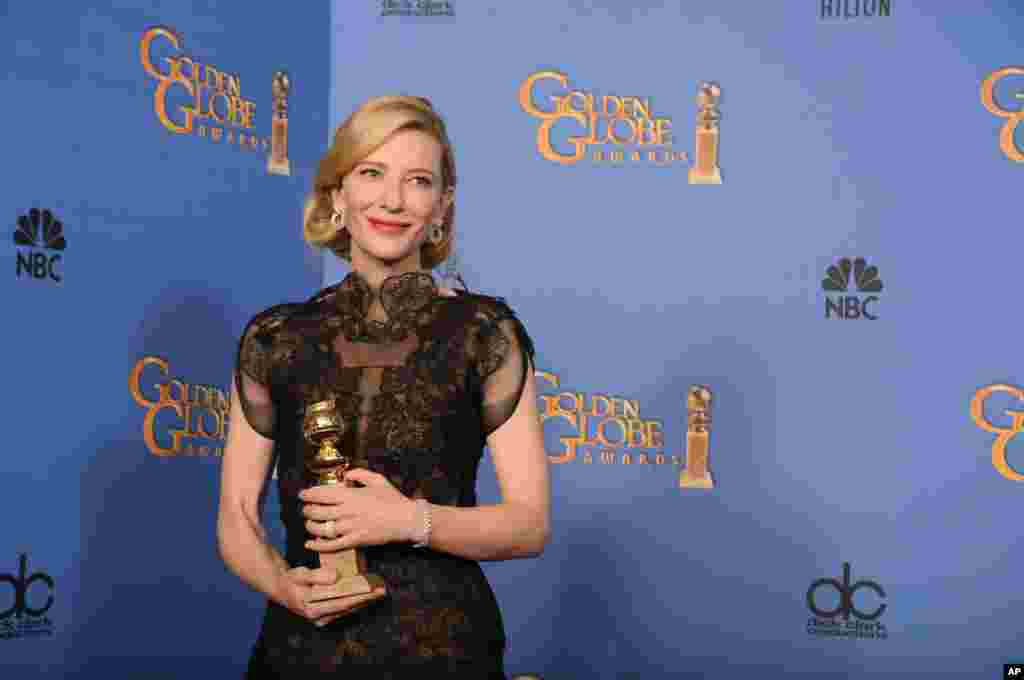 """Cate Blanchett poses with the award for best actress in a motion picture - drama for """"Blue Jasmine"""" at Golden Globe Awards at the Beverly Hilton Hotel, Jan. 12, 2014."""