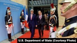 U.S. Secretary of State John Kerry, left, walks with Special Envoy for Israeli-Palestinian Negotiations Frank Lowenstein as they exit the MFA Convention Center in Paris, France, following a French-sponsored conference focused on Middle East peace efforts,