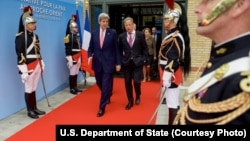 U.S. Secretary of State John Kerry, left, walks with Special Envoy for Israeli-Palestinian Negotiations Frank Lowenstein as they exit the MFA Convention Center in Paris, France, following a French-sponsored Middle East conference, June 3, 2016.