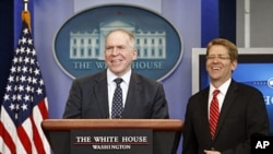 John Brennan (L), assistant to the president for homeland security and counterterrorism, and White House Press Secretary Jay Carney.