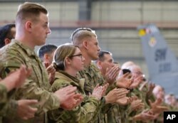 Troops applaud as U.S. Vice President Mike Pence speaks in a hangar at Bagram Air Base in Afghanistan, Dec. 21, 2017.