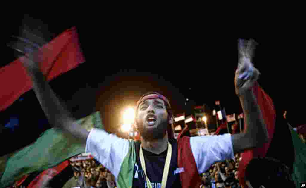 Tens of thousands of Libyans celebrate the fall of Tripoli to Libyan rebels on Aug. 21, 2011 in Benghazi, Libya. (AFP)