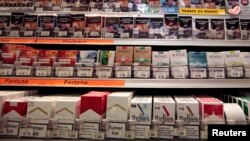 FILE - Cigarette packs are seen on shelves in a tobacco shop in Cagnes-sur-Mer, France, Sept. 8, 2015. (REUTERS/Eric Gaillard)