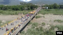 Migranti iz Venecuele na granici sa Kolumbijom