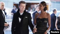 FILE - David Bowie arrives with his wife Iman to attend the CFDA fashion awards in New York, June 7, 2010.