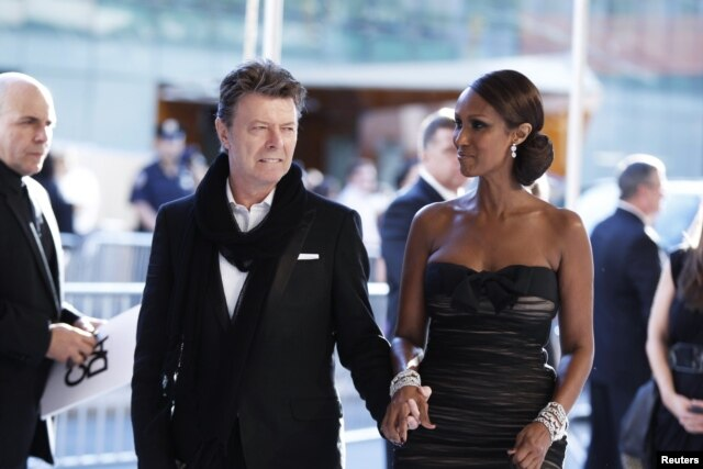 FILE - Singer David Bowie arrives with his wife, Iman, to attend the CFDA fashion awards in New York, June 7, 2010.