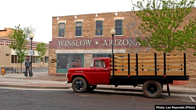 A flatbed Ford truck permanently parked at Standin' on the Corner Park, in Winslow, Arizona, as a tribute to the Eagles song 'Take it Easy,' written by Jackson Browne & Glenn Frey.