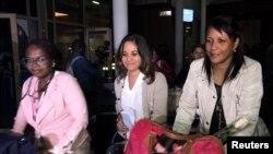 FILE - Cuban doctors arrive at the Jomo Kenyatta International Airport amid controversy surrounding their pay in Nairobi, Kenya, June 5, 2018.