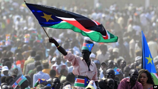 A man waves South Sudan's national flag as he attends the Independence Day celebrations in the capital Juba, July 9, 2011.