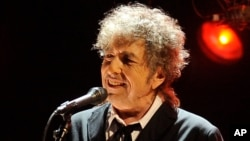 FILE - In this Jan. 12, 2012 file photo, Bob Dylan performs in Los Angeles.