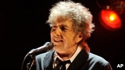 FILE - Bob Dylan performs in Los Angeles, Jan. 12, 2012.