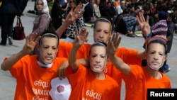 Supporters of the ruling AK Party wear Prime Minister Tayyip Erdogan masks during an election rally in Konya, central Turkey, Mar. 28, 2014.