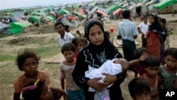 An internally displaced Rohingya woman holds her newborn baby. (file)