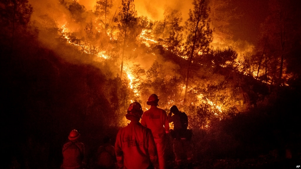 Firefighters monitor a backfire while battling the Ranch Fire, part of the Mendocino Complex Fire, on Aug. 7, 2018, near Ladoga, Calif. (AP Photo/Noah Berger)