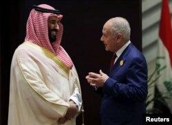 Saudi Arabia's Crown Prince Mohammed bin Salman talks with Secretary General of Arab League, Ahmed Aboul Gheit, ahead of the 29th Arab Summit in Dhahran, Saudi Arabia, April 15, 2018.