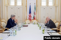 FILE - U.S. Secretary of State John Kerry sits across from Iranian Foreign Minister Javad Zarif on June 30, 2015, in Vienna, Austria, before a one-on-one meeting. (Photo: State Department)