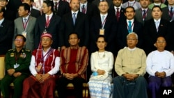 First row, left to right; Myanmar's Army Commander Senior Gen. Min Aung Hlaing, Myanmar Upper House speaker of Mann Win Khaing Than, Vice President Henry Van Hti Yu, Foreign Minister Aung San Suu Kyi, President Htin Kyaw, and Vice President Mint Swe, sit for a photo session following the Union Peace Conference-21st Century Panglong at the Myanmar International Convention Centre, Aug. 31, 2016, in Naypyitaw, Myanmar.