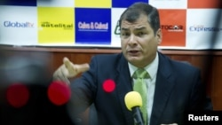 Ecuador's President Rafael Correa gestures during an interview in Loja, Ecuador, August 17, 2012.