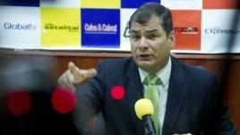 Ecuador's President Rafael Correa gestures during an interview in Loja, Ecuador, August 17, 2012.