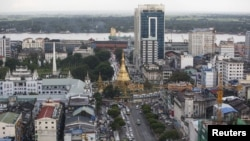 Sule pagoda seen among the building in Yangon city September 23, 2015. Arrangements have been underway to implement a new city project outside the commercial capital Yangon to cope with the speedy increasing population. However only three out of 54 compan