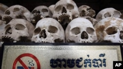 "Human sculls are displayed in the stupa of Choeung Ek, a former Khmer Rouge ""killing field"" dotted with mass graves about nine miles (15 kilometers) south of Phnom Penh."