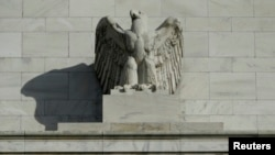 FILE - A detail from the front of the U.S. Federal Reserve Board building is shown in Washington.