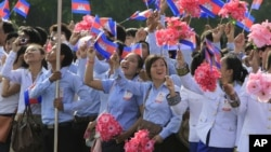 Cambodian students wave their national flags during a ceremony to celebrate its Independence Day, file photo.