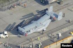 Pesawat MV-22 Osprey tiba di Pangkalan Udara Iwakuni, Jepang barat (23/7). (Foto:REUTERS/Kyodo)