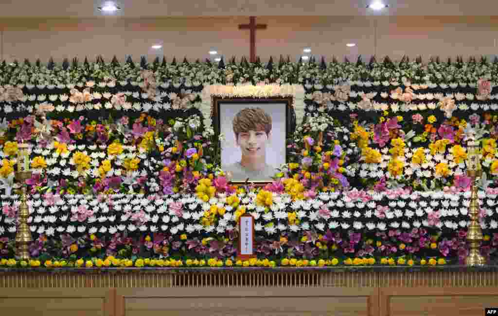 The portrait of Kim Jong-Hyun, a 27-year-old lead singer of the hugely popular K-pop boy band SHINee, is seen on a mourning altar at a hospital in Seoul.