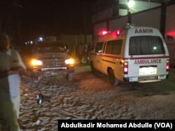 One of the Aamin ambulances waits outside Pizza House as Somali security forces end an al-Shabab siege of two Mogadishu restaurants early Thursday morning.