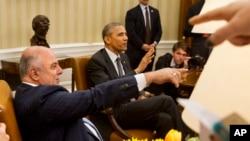 Thủ tướng Iraq (trái) trong cuộc gặp với Tổng thống Barack Obama tại Tòa Bạch Ốc hồi tháng Tư.