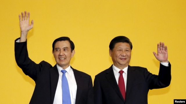 FILE - Chinese President Xi Jinping and Taiwan's President Ma Ying-jeou, left, wave to the media during a summit in Singapore, Nov. 7, 2015.