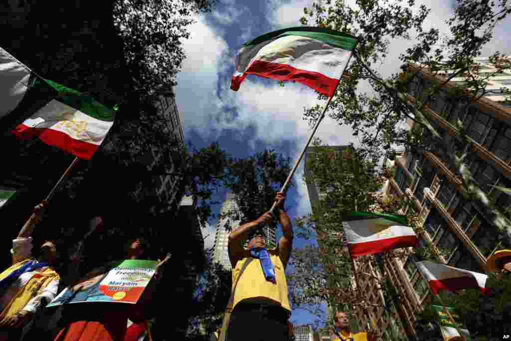 Supporters of a leadership change in Iran demonstrate outside United Nations headquarters on the first day of the general debate at the U.N. General Assembly in New York.