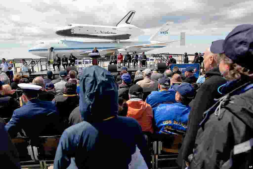 The space shuttle Enterprise, mated on the back of the NASA 747 Shuttle Carrier Aircraft, rests on the tarmac before a crowd of spectators at JFK International Airport, April 27, 2012, in New York. Enterprise is eventually going to make its new home in