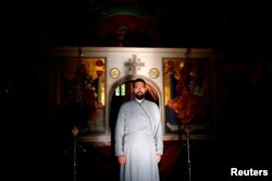 FILE - Hierodeacon Nektarije poses for a photograph at Zitomislic Serbian Orthodox monastery in Zitomislici, Bosnia and Herzegovina, July 27, 2017.