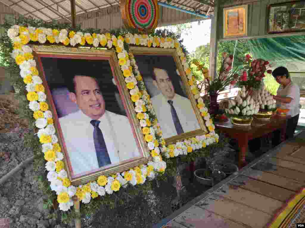 Two side-by-side portraits of social analyst Kem Ley are on display at his hometown in Takeo province, Cambodia, July 02, 2017. (Hul Reaksmey/VOA Khmer)