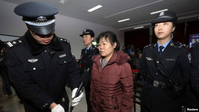 FILE - Zhang Shuxia, an obstetrician involved in baby trafficking, stands trial in Weinan Intermediate People's Court in Weinan, Shaanxi province.