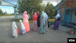 Members of the Old Believers community, wearing traditional clothes, in Nikolaevsk, Alaska.