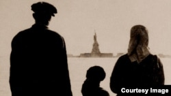 An immigrant family views the Statue of Liberty from Ellis Island in New York.