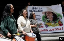 Women demanding justice for the slaying of Honduran Indian leader Berta Caceres play drums during a demonstration at the entrance of the Honduran Embassy in Quito, Ecuador, March 4, 2016.