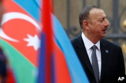 FILE - President of Azerbaijan Ilham Aliyev arrives for a meeting on the 5th anniversary of the Eastern Partnership at the Prague Castle in Prague, Czech Republic.