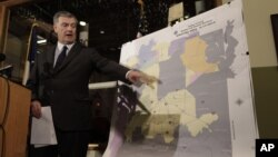 Dallas Mayor Mike Rawlings points to a map showing Dallas County and the aerial spraying against mosquitos during a news conference in Dallas, Aug. 17, 2012.