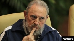Former Cuban leader Fidel Castro attends the closing ceremony of the sixth Cuban Communist Party (PCC) congress in Havana in this April 19, 2011 file photo.