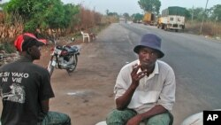 A truck driver takes a break on the line that separates northern rebel-held Ivory Coast from the government-run south (file photo)