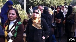 Women wait in a queue to vote in Egypt's first post-revolutionary elections, Cairo, Egypt, November 28, 2011.