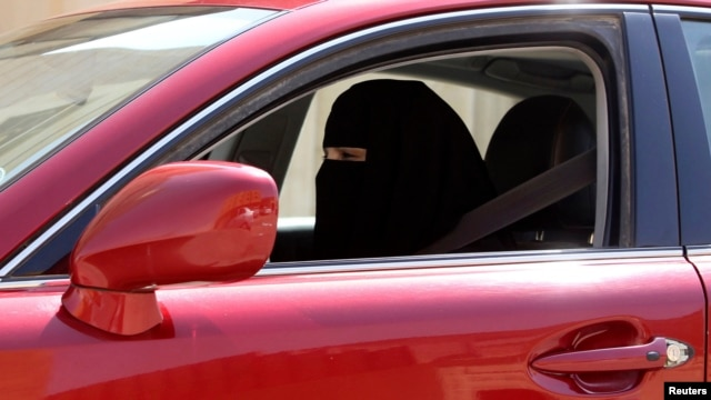 A woman drives a car in Saudi Arabia on October 22, 2013.  Saudi Arabia is the only country in the world where women are barred from driving, but debate about the ban is growing.