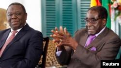 Tổng thống Robert Mugabe (phải) và Thủ tướng Morgan Tsvangirai của Zimbabwe