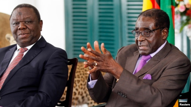 Zimbabwean President Robert Mugabe (R) and Prime Minister Morgan Tsvangirai address a media conference in Harare, January 17, 2013.