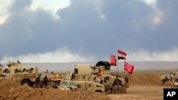Thủ tướng Iraq Haider al-Abadi yêu cầu hỗ trợ cho cuộc phản công của lực lượng chính phủ và dân quân Shia kéo dài một tháng để chiếm lại khu vực chiến lược Tikrit.