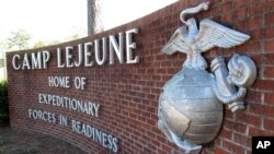 FILE - This photo, taken March 19, 2013, features a globe and anchor display at the entrance to Camp Lejeune, North Carolina.